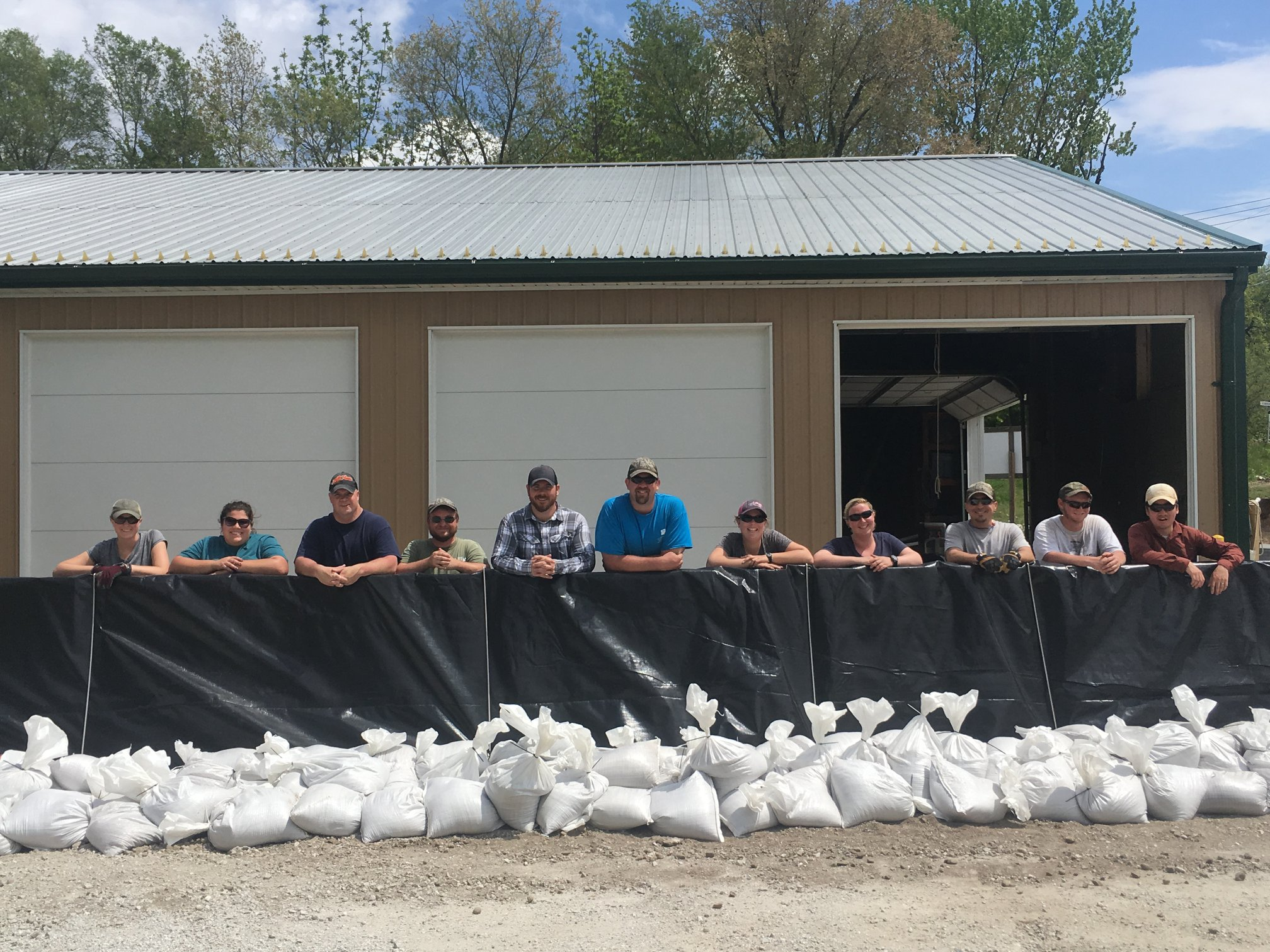 IRBS staff members behind flood wall