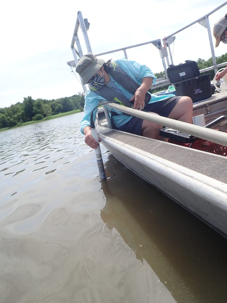 Technician taking a water quality sample